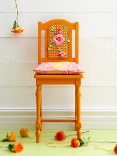 After: Cool Seat  A fresh coat of orange spray paint and flower embellishments stitched on with yarn gave the chair a new look. Free-form flowers are easy to make with cotton fabric. To make the flowers, cut several sizes of pink blooms and a smaller center shape. Using a darning needle, thread yard from the back of the fabric to the front, making a French knot.
