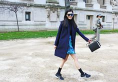 Sporty chic street style at Paris Fashion Week Fall 2014. Get the look: Proenza Schouler + Fendi + Nike shoes