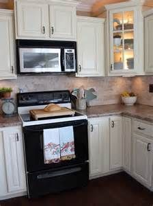 kitchen designs with black appliances |  . these jazz the look