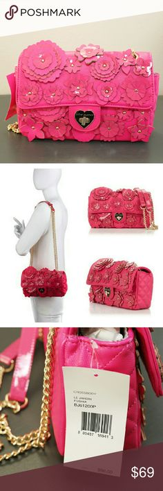 FINAL PRICE! VALENTINE'S❤Betsey Johnson Handbag Someone really needs this before Valentine's day!!  Super cute Betsey Johnson purse.  Pink with flower cutouts on one side.  Crossbody.  Gold chain link straps.  Brand new with tags.  Retail $98 Betsey Johnson Bags Crossbody Bags