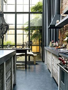Would love a kitchen like this - concrete floors and counters with rustic reclaimed wood cabinets.