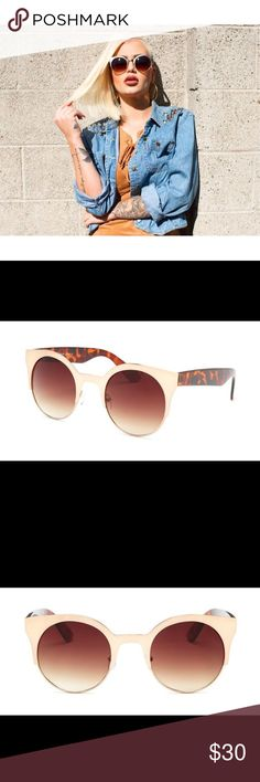 Gold and Tortoise Sunglasses Frame Color: Gold & Tortoise  Lens Color: Brown  Materials: Plastic & Metal  UV Protection: 100% Accessories Sunglasses