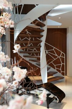 Residential helical EeStairs staircase featuring Cells® balustrade.