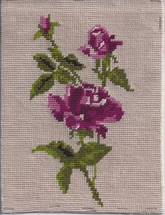 You are buying a pre-worked needlepoint canvas featuring purple roses.    This one is complete, blocked to cardboard, ready to frame.    No