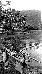 Children paddling canoe in lagoon. Tutuila, Am. Samoa. 1940  Wayne A. Forde Photo Collection