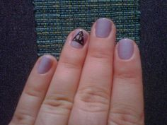 My nails in honor of HP7.2.  St. Lucia Lilac by Essie with a Deathly Hallows symbol on the ring finger. Add some glitter over the design and TADA!