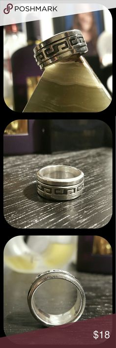Men's Sterling Aztec Spinner Ring Band This ring has a spinning outer ring. Great for guys who love to fidget! Made in Mexico. Stamped 925 inside. Black Aztec inlay. Size 9. Unknown Accessories Jewelry