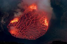 View onto the boiling lava lake inside the giant crater of Nyiragongo volcano. The volcano is located inside Virunga National Park, in the Democratic Republic of the Congo. The lake has a diameter of approximately 250m.