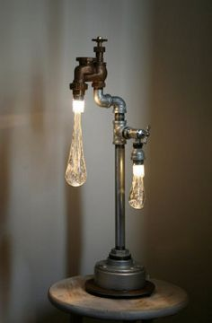 "Created by Tanya Clarke, these retro lamps and chandeliers are made out of recycled plumbing hardware, LED lights and hand sculpted glass drops. ""Liquid Lights are custom built, industrial designed light installations that experiment with fusion of art, function and environmental consciousness."" describes her website."