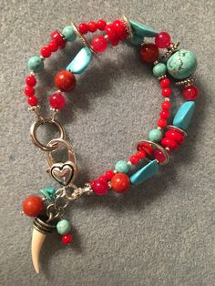 Turquoise, coral & silver always makes a great bracelet.