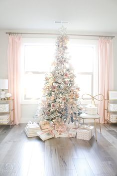 Sharing my Flocked Christmas Tree in my office with blush pink, champagne, and gold ornaments and ribbons. Shopping links included for your convenience. #christmastreedecoration