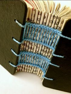 Variation on Coptic binding by Cantiero De Alfaces - awesome #bookbinding