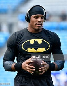 Cam Newton of the Carolina Panthers warms up before playing the New England Patriots during their preseason NFL game at Bank of America Stadium on August 28, 2015 in Charlotte, North Carolina.