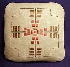 Arts and Crafts geometric embroidered pillow.