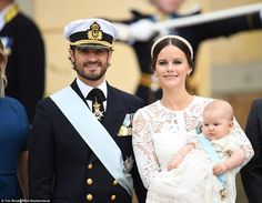 Resplendent in a white lace dress, pearl headband and cream satin heels, Princess Sofia, 31, beamed  flanked by her dapper husband, 37-year-old Prince Carl Philip