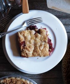 In this recipe, an entire jelly roll pan becomes the perfect vessel for a crowd-pleasing pie. Coat the bottom with a layer of piecrust, fill with a tangy cherry-cranberry mixture, and top with another layer of piecrust. Serve with plenty of vanilla ice cream.