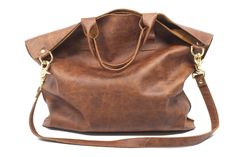 Not too big and not too small, the Courier East West Tote is the perfect sized crossbody bag. And such soft leather too!
