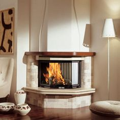 Edilkamin - Fireplaces, wood and pellet burning stoves, fireplace heating systems, thermo-stoves, pellets Corner Stone Fireplace, Cottage Fireplace, Home Fireplace, Faux Fireplace, Fireplace Design, Granite Hearth, Classic Fireplace, Wood Mantels, Ceiling Light Design