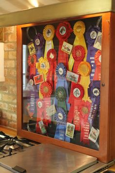 The Polohouse. Brought my shadow box of vintage ribbons for the staging in the kitchen.
