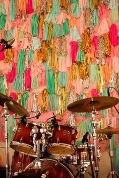 Wall of tassels [designed by Caplan Miller Events]. Tassel garland tutorial: http://www.thesweetestoccasion.com/2011/10/diy-tassel-garland/#