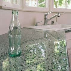 Want!! Recycled glass turned into counter tops for the kitchen. Coke bottles are used for the slightly green tint.