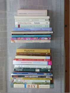 DIY INVISIBLE BOOKSHELVEDS THAT DON'T DESTROY A BOOK! You've all seen these invisible bookshelves, right? The books stack horizontally and and appear to just float on the wall. They look really cool, but they can cost a bundle.    Fortunately, they're easy and cheap to make from simple L-brackets. A bit of careful measuring and making sure they're level, and you're ready to start stacking.