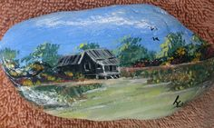 This is a rock that I picked up in Pigeon Forge several years ago while we were on vacation. It is painted with acrylic and features a old white