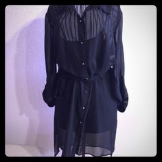 """Hi Low Blouse or Dress NWOT sexy sheer button down blouse or dress. Buttons are silver spikes. Comes with a size large soft black tank top to pair with leggings or tights. If wearing as a dress, will need to wear slip (not included), just a styling suggestion. Perfect amount of flirty for Valentine's or girls night out. Very tiny snag pointed out in last photo, hardly noticeable. Size is more of a juniors true medium. Front measures 36.5"""" and back 38.5"""" Self Esteem Tops"""