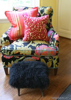 Beautiful chair! I like the bold fabric on the chair with the contrasting fabrics on the pillows, then the pop of fur on the foot stool.