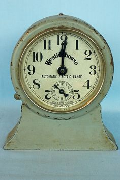 """This old Westinghouse Automatic Electric Range Clock has a patent date of Apr. 27 1920. The style is S-521592. It is 5 1/2"""" tall with a 4"""" diameter dial.This was a primitive forerunner of automatic oven controls as found on today's stoves, although nowhere nearly as sophisticated. Tin Can Alley www.bagtheweb.com/b/UG8KRi inside the Castle Rock Mercantile Antique Mall 160 H Huntington Avenue N Castle Rock, WA 98611 bagtheweb.com/b/E7Kxc0 Vintage Northwest: bagtheweb.com/vintage"""