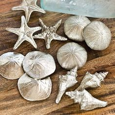 Set of 12 assorted silver mini seashells (price is for 4 sets).