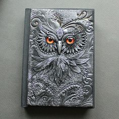 """Owl with golden eyes"" Polymer clay journal by Mandarin Duck. I received a beautiful OWL leather journal at Christmas time from friend Meg.thanks, Megan! Polymer Clay Kunst, Polymer Clay Projects, Polymer Journal, Metal Embossing, Journal Covers, Book Covers, Handmade Books, Handmade Journals, Book Of Shadows"