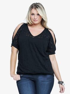 A heart burnout print patterns this black cold-shoulder tee. The easy, effortless silhouette is shaped by a V-neckline, dolman sleeves and a banded bottom.