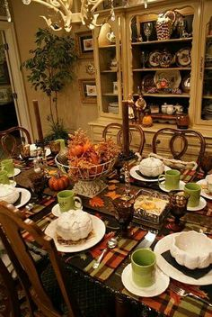 Nice mix of colors. I would put a bright orange tablecloth under the placemats to give it a little more pop