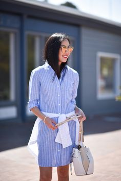 This Summer Staple Can Be Worn To The Office And Beyond - Cute Blue And White Striped Shirt Dress Summer Street Style