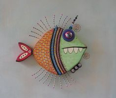 Original art work by Kerry Heath.    This colorful sea creature is hand carved in salvaged pine and brought to life with found objects and acrylic