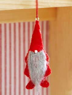 Invite a lovable Christmas gnome to your holiday celebration. These bearded little felt ornaments are a fun and easy Christmas craft that will give your Christmas tree an Old World feel.