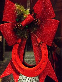 Red Horseshoe and Red Bow, Christmas in Stockyards, Fort Worth, Texas. Merrrrrrrrrry Christmas Every One! Western Christmas, Noel Christmas, Country Christmas, All Things Christmas, Christmas Wreaths, Christmas Decorations, Christmas Ornaments, Xmas, Christmas Ideas