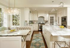 """Benjamin Moore """"Snowfall White"""" color of cabinets.The tile on the backsplash is 3/4 Inch Curved White Milk Glass Subway Tile, by Susan Jablon.Pic by Harry Braswell Inc."""