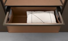 Want to know where to put all those throw pillows? Why in this big tray in castoro regenerated leather finishing. #Cover #storage system by #Rimadesio