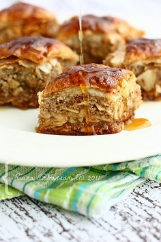 Baklava, is a rich pastry made of layers of phyllo dough filled with chopped nuts and sweetened with syrup or honey.  In Iraq, it is likely to contain cardamom and lemon zest.