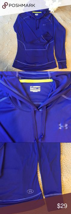 UnderArmour Training Hoodie with a Kangaroo Pocket UnderArmour Long Sleeve Training Hoodie with a Kangaroo Pocket On trend.  Great condition.  Color: a blue/purple blend Features:  🔹 Recycled Polyester / Elastane blend saves resources and decreases emissions 🔹Relaxed Fit - loose and roomy for comfort and freedom of movement 🔹Long-sleeve construction  Fast shipping! Under Armour Tops Tees - Long Sleeve
