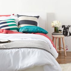 Brighten up your bedroom with bold pillows.