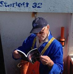 A fisherman reading about Captain Shelby  (maybe he will now try to find a secret fishing spot)