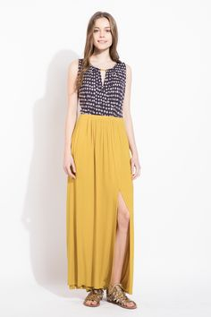 Amazing 2 in 1 dress! Love how this is made to look like a top tucked into a skirt when it's really a gorgeous maxi. Love the mustard yellow color and the touch of print adds some interest!