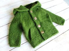 This soft and bulky hooded boys sweater will fit toddler boys up to 2 years old, size 24 months.  Hand knitted bright green hoodie features