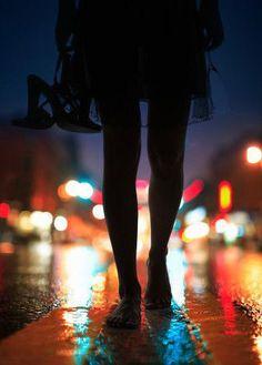 City lights on wet pavement. silhouette