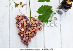 picture of stylized bunch of grapes with wine cork and glass and bottle of wine