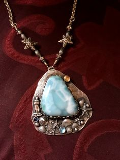 """Reserved for JS only.   Merry Christmas.  I hope your Mom will find much comfort and wonderful beach memories as she wears her new Paradise necklace.  Thank you for this request.  It has been an extreme pleasure to create this for a sweet lady!  Materials as discussed, Larimar, sapphire, Topaz, citrine, fine silver, sterling silver.     Pendant:  2 1/8""""  x 1 7/8"""" Length:  20 7/8""""   With gratitude, Julie"""
