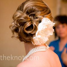 Pretty swooping wedding hair idea. Not sure how the veil would go with this look, but I'm sure it could happen...